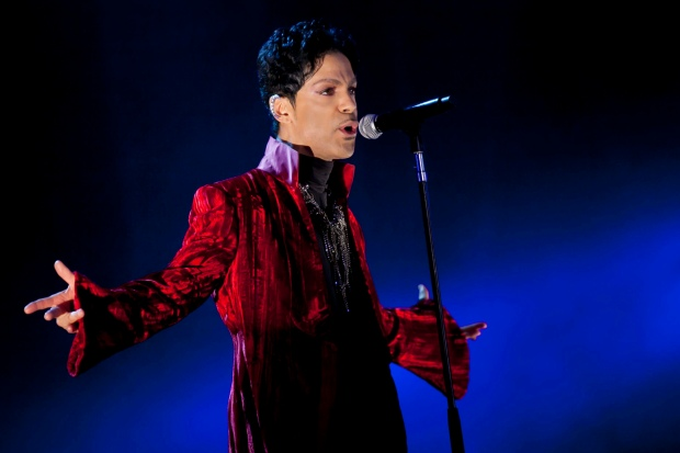 "FILE - In this Aug. 9, 2011 file photo, U.S. musician Prince performs during his concert at the Sziget Festival on the Shipyard Island, northern Budapest, Hungary. The enigmatic star flew into London on Tuesday, Feb. 4, 2014, at the start of a still-evolving string of dates in support of forthcoming album ""Plectrum Electrum,"" recorded with all-female trio 3RDEYEGIRL. (AP Photo/MTI, Balazs Mohai, File) HUNGARY OUT"